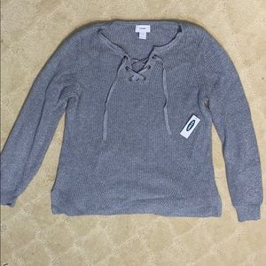 Gray sweater with neck detailing